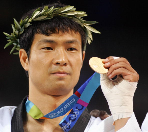 Athens, GREECE: Moon Dae-Sung of South Korea celebrates his Olympic Games gold medal victory in the +80 kg taekwondo final 29 August 2004 in Athens. Moon knocked out hometown hero Alexandros Nikolaidis, topping off South Korea's gold medal campaign in their own sport at a modest two. AFP PHOTO / Franck FIFE (Photo credit should read FRANCK FIFE/AFP/Getty Images)